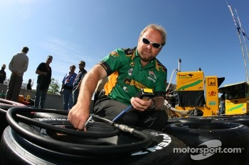 Team Australia crew member prepares wheels
