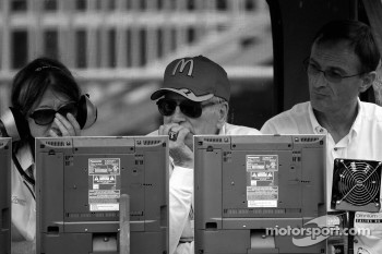 Paul Newman and Patrick Bourdais watch the race