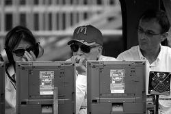 Paul Newman and Patrick Bourdais watch the race