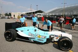 Newman/Haas/Lanigan Racing crew members take Graham Rahal's car back to the paddock