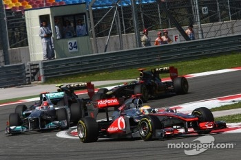 Lewis Hamilton, McLaren Mercedes leads Michael Schumacher, Mercedes GP F1 Team