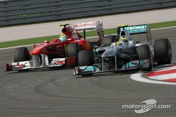 Felipe Massa, Scuderia Ferrari and Nico Rosberg, Mercedes GP F1 Team