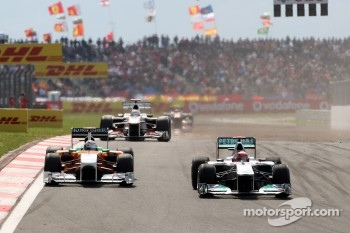 Michael Schumacher, Mercedes GP F1 Team, MGP W02 leads Adrian Sutil, Force India F1 Team, VJM-04