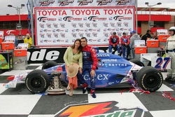 Race winner Dario Franchitti celebrates with wife Ashley