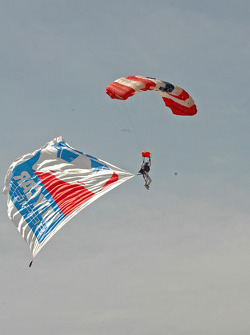 Skydiver arrives with the American Flag