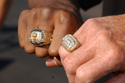 Heavyweight champion Lamon Brewster and Al Unser Sr. compare rings