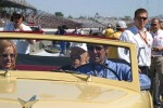 Tony George gives Tom Carnagie a ride in a vintage pace car