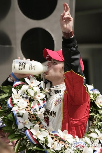Victory lane: race winner Dan Wheldon tastes the Indiana milk