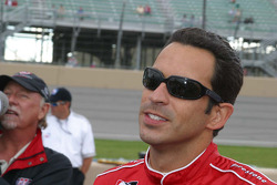 Helio Castroneves waits to see if he wins the pole