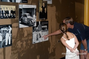 Johnny Unser shows daughter Loni her grandfather Jerry Jr.'s photo in Jerry's Garage