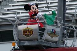 Minnie waves the green flag