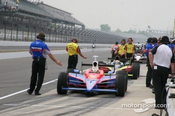 Teams wait for the green flag to practice for the 90th Indianapolis 500