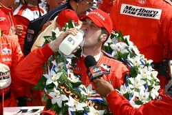 Race winner Sam Hornish Jr. drinks the traditional Indy 500 winners' milk