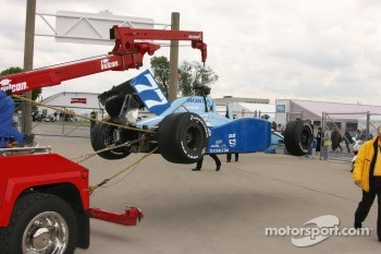 The wrecked car of Stephan Gregoire is brought back to the garage