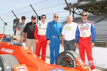 A.J. Foyt IV, A.J. Foyt, Larry Foyt, Al Unser Jr., George Snider and Darren Manning pose next to one of A.J. Foyt's Indy 500 winning cars