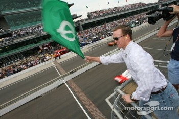 Start: Indianapolis quarterback Peyton Manning waves the green flag