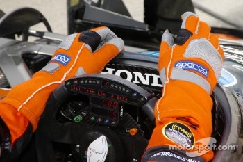 Dario Franchitti relaxes his hands ready to go