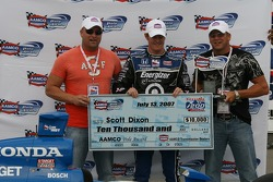 Pole winner Scott Dixon accepts the pole award check
