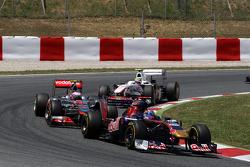 Sebastien Buemi, Scuderia Toro Rosso, leads Jenson Button, McLaren Mercedes