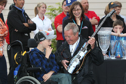 Victory lane: Hurley Haywood swowing off his new guitar