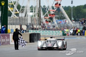 Race winner Andre Lotterer takes the checkered flag
