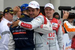 Race winner Benoit Tréluyer celebrates with Sébastien Bourdais