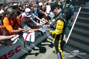 Paul Menard signs autographs for fans
