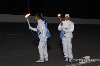 Eddie Cheever receives the Olympic Torch from Tony George
