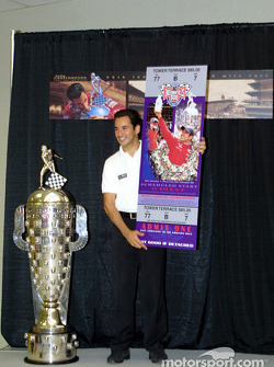 Borg Warner Trophy conference: Helio Castroneves with the Borg Warner Trophy and a large version of the race day ticket