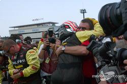Race winner Scott Sharp arrives on victory lane