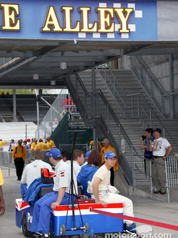 Super Aguri Fernandez Team crew head out to pitlane