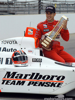 Pole winner Helio Castroneves with the MBNA pole trophy