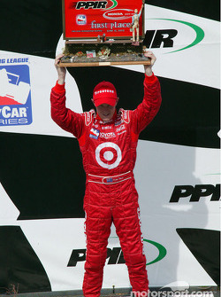 Scott Dixon accepts the winner's trophy