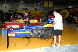 Panther Racing crew works on Dallara chassis of driver Mark Taylor