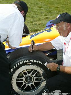Crew member checks tire temperature