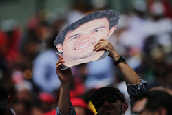A fan with a Sergio Perez, Sahara Force India F1 cut out head