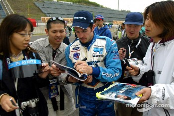 Patrick Carpentier signing autographs