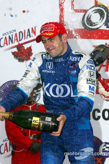 The podium: champagne for Dario Franchitti