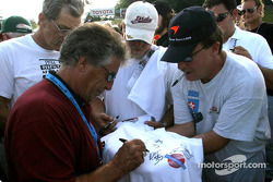 Mario Andretti signs autographs