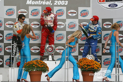 Podium: champagne for Michel Jourdain Jr., Oriol Servia and Patrick Carpentier, while the Molson Dry girls run for their life