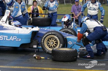 Forsythe Racing crew members replace front nose on Paul Tracy's car