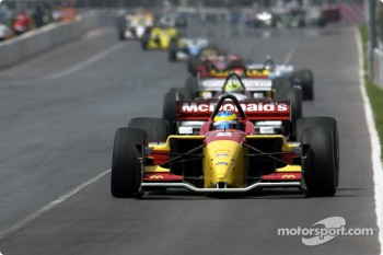 Sébastien Bourdais leads the field on lap 1
