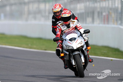 Bike champion Miguel Duhamel rides a fan around the Circuit Gilles-Villeneuve