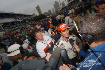 Race winner Bruno Junqueira gives interviews