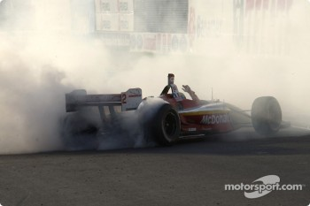 Race winner and 2004 Champ Car World Series champion Sébastien Bourdais celebrates by smoking the tires