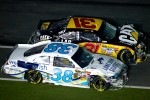 Crash on the last lap, exiting turn 4: Jeff Burton, Richard Childress Racing Chevrolet and Travis Kvapil, Front Row Motorsports Ford
