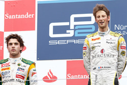 Romain Grosjean celebrates his victory on the podium