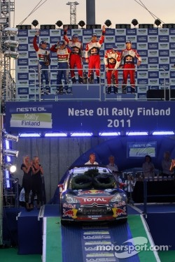 Podium: winners Sébastien Loeb and Daniel Elena, second place Jari-Matti Latvala and Miikka Anttila, third place Sébastien Ogier and Julien Ingrassia