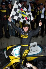 Victory lane: race winner Marcos Ambrose, Petty Motorsport Ford celebrates