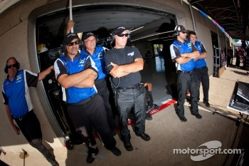 Spirit of Daytona Racing team members watch qualifying